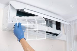 128703324 technician cleaning air conditioner hand holding air conditioning filter 300x200 - شركة تنظيف مكيفات بحفر الباطن- 0554068868