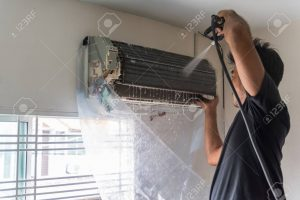 90427004 worker to cleaning coil cooler of air conditioner by water for clean a dust on the wall in customer 300x200 - شركة تنظيف مكيفات بسكاكا - 0509403136 - مكيفات سبليت شباك بسكاكا